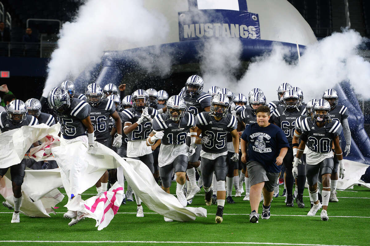 West Orange-Stark players rush onto the field before they play Pleasant Grove in the Class 4A Division II state final at AT&T Stadium in Arlington on Friday. Photo taken Friday 12/22/17 Ryan Pelham/The Enterprise