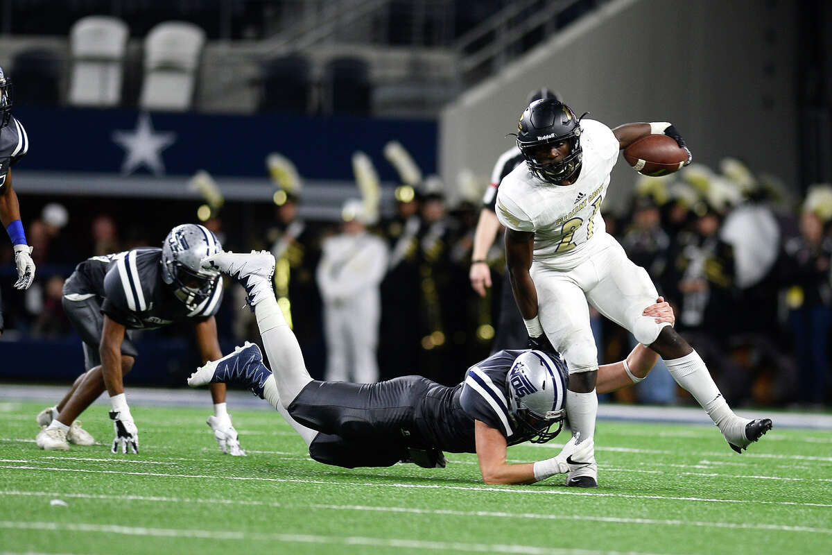 Pleasant Grove's Chauncey Martin is grabbed by a West Orange-Stark defender during the second quarter against in the Class 4A Division II state final at AT&T Stadium in Arlington on Friday. Photo taken Friday 12/22/17 Ryan Pelham/The Enterprise