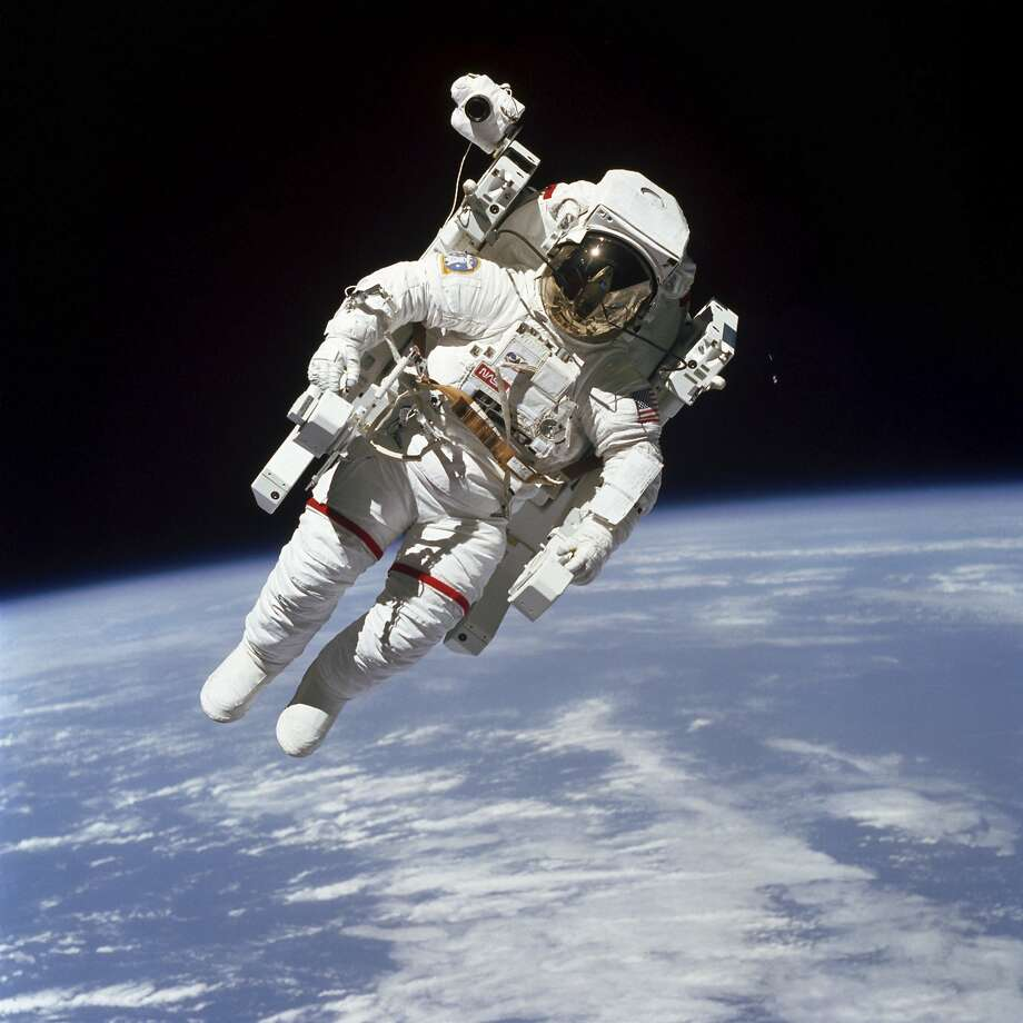 In a photo provided by Nasa, Bruce McCandless uses a nitrogen-propelled thruster unit to perform the first-ever untethered spacewalk, on Feb. 7, 1984. McCandless, a highly-decorated astronaut for more than two decades, died on Dec. 21, 2017. He was 80. (NASA via The New York Times) -- FOR EDITORIAL USE ONLY -- Photo: NASA, NYT