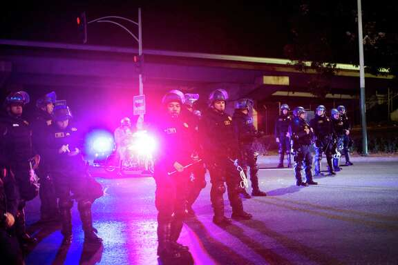 Oakland officers guard a freeway entrance near where protesters were marching against Donald Trump's election Nov. 12, 2016.