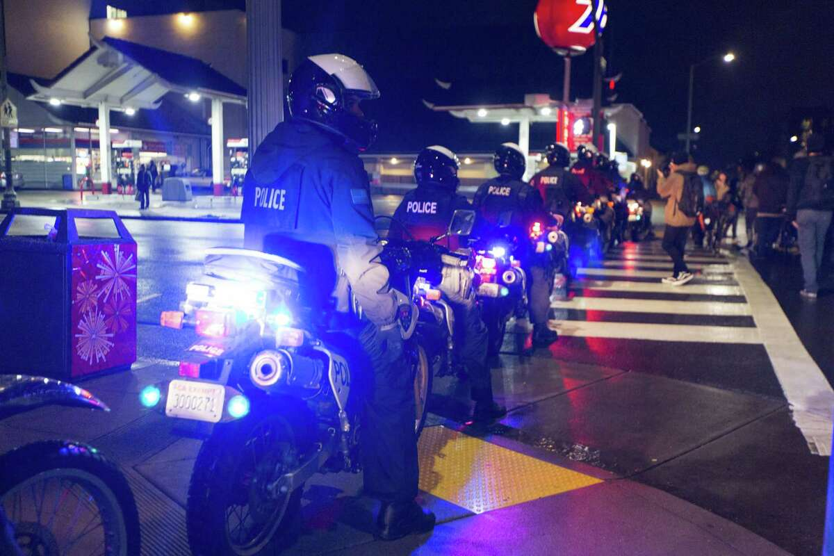 Police block a street as an anti-Trump rally marches around downtown Oakland in January.