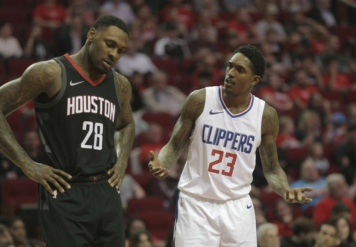LA Clippers guard Lou Williams (23) contests a foul called in the first quarter as Houston Rockets forward Tarik Black (28) listens at the Toyota Center on Friday, Dec. 22, 2017, in Houston. ( Elizabeth Conley / Houston Chronicle )