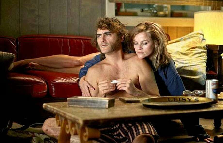 """Joaquin Phoenix and Reese Witherspoon in Paul Thomas Anderson's """"Inherent Vice"""" (2014). Photo: Contributed Photo"""