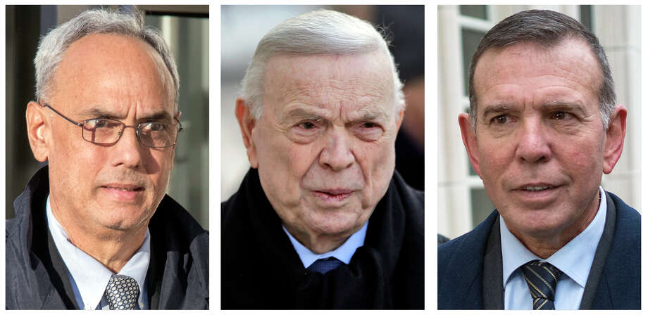 FILE - In these 2017 file photo, three former South American soccer officials, from left, Manuel Burga, of Peru; Jose Maria Marin, of Brazil; and Juan Angel Napout, of Paraguay, accused of accepting millions of dollars in bribes, are shown outside federal court in the Brooklyn borough of New York. The three are among the more than 40 soccer officials, businessmen and entities charged in a scandal that's shaken FIFA, soccer's governing body. (AP Photo/File) / AP2011