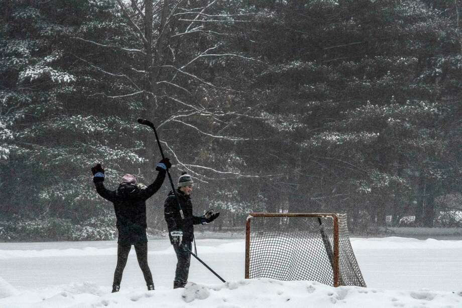 Allie Alopes, 19, of Boston scores a goal on Kyle Valiquette, 18, of Saratoga Springs during a friendly game of hockey on the ice at the Saratoga State Park Friday Dec 22, 2017 in Saratoga Springs, N.Y.  (Skip Dickstein/ Times Union) Photo: SKIP DICKSTEIN
