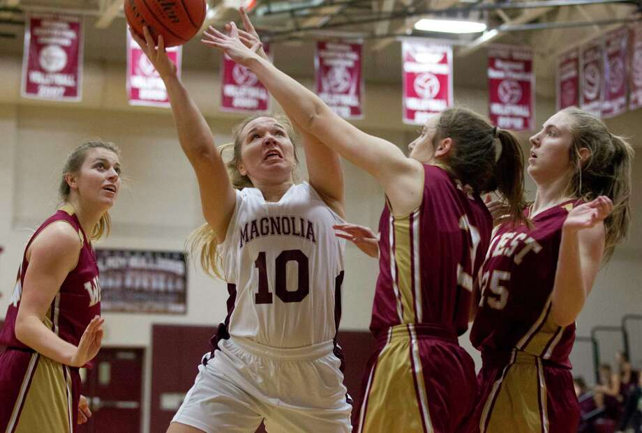 Magnolia guard Lexi Bearden (10) is pressured by Magnoia West guard Tia Fredericks (3) during the first quarter of a District 20-5A high school girls basketball game at Magnolia High School, Friday, Dec. 22, 2017, in Magnolia. Photo: Jason Fochtman, Staff Photographer / © 2017 Houston Chronicle