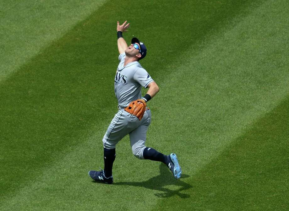 CLEVELAND, OH - MAY 17, 2017: Thirdbaseman Evan Longoria #3 of the Tampa Bay Rays fields a fly ball during a game on May 17, 2017 against the Cleveland Indians at Progressive Field in Cleveland, Ohio. Tampa Bay won 7-4.  17-05179891 2017 Nick Cammett/Diamond Images/Getty Images Photo: Diamond Images / Diamond Images/Getty Images / 2017 DIAMOND IMAGES