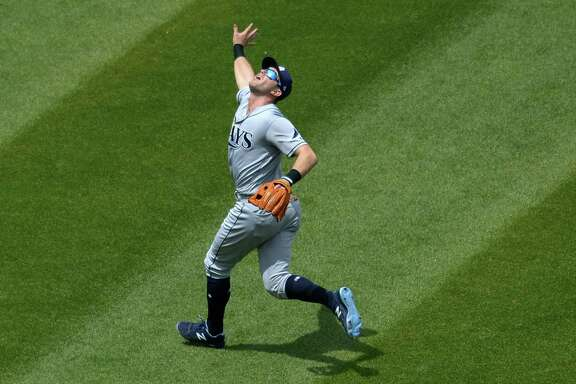 CLEVELAND, OH - MAY 17, 2017: Thirdbaseman Evan Longoria #3 of the Tampa Bay Rays fields a fly ball during a game on May 17, 2017 against the Cleveland Indians at Progressive Field in Cleveland, Ohio. Tampa Bay won 7-4.  17-05179891 2017 Nick Cammett/Diamond Images/Getty Images