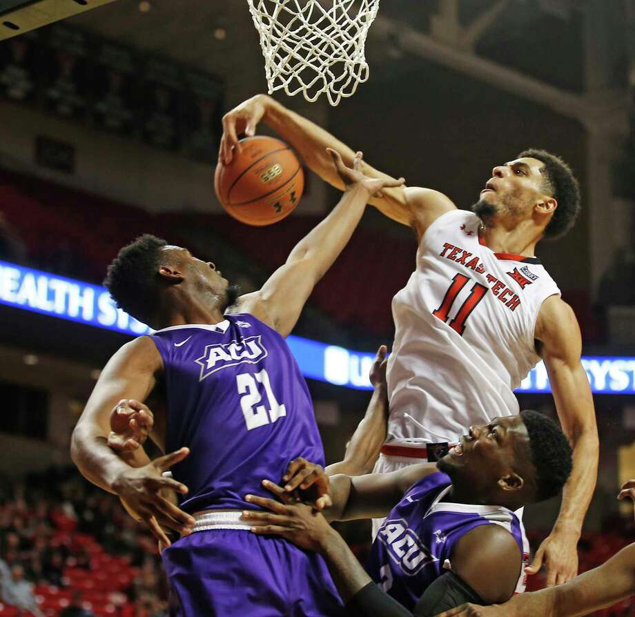 Texas Tech's Zach Smith, right, snatches a rebound away from Abilene Christian's Jalone Friday in the second half of Friday's game at Lubbock. Photo: Brad Tollefson, FRE / FR171432 AP