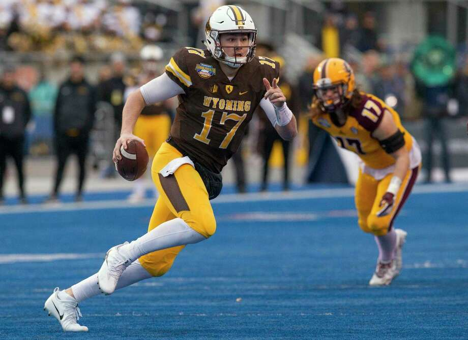 Wyoming quarterback Josh Allen (17) runs with the ball against Central Michigan during the Famous Idaho Potato Bowl NCAA college football game Friday, Dec. 22, 2017, in Boise, Idaho. (Darin Oswald/Idaho Statesman via AP) Photo: Darin Oswald / Idaho Statesman