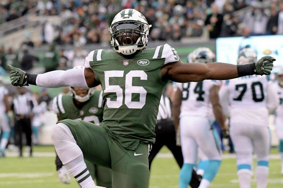 FILE - In this Nov. 26, 2017, file photo, New York Jets inside linebacker Demario Davis (56) reacts after a play against the Carolina Panthers during the second half of an NFL football game in East Rutherford, N.J. Davis is having the best season of his career in his sixth year in the NFL.  (AP Photo/Bill Kostroun, File) Photo: Bill Kostroun / FR51951 AP