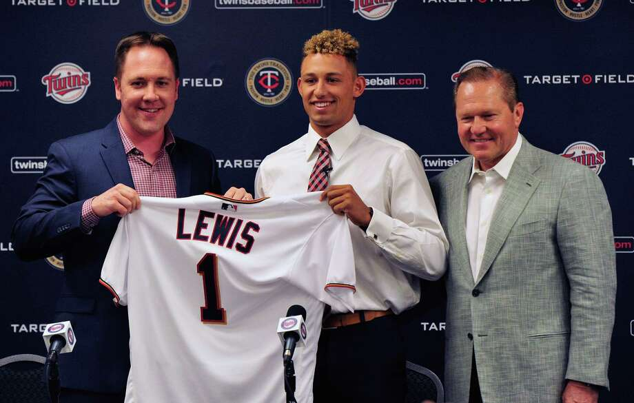 MINNEAPOLIS, MN - JUNE 17: Chief Baseball Officer Derek Falvey of the Minnesota Twins holds up a jersey with number one overall draft pick Royce Lewis and agent Scott Boras at a press conference on June 17, 2017 at Target Field in Minneapolis, Minnesota. (Photo by Hannah Foslien/Getty Images) ORG XMIT: 700010444 Photo: Hannah Foslien / 2017 Getty Images