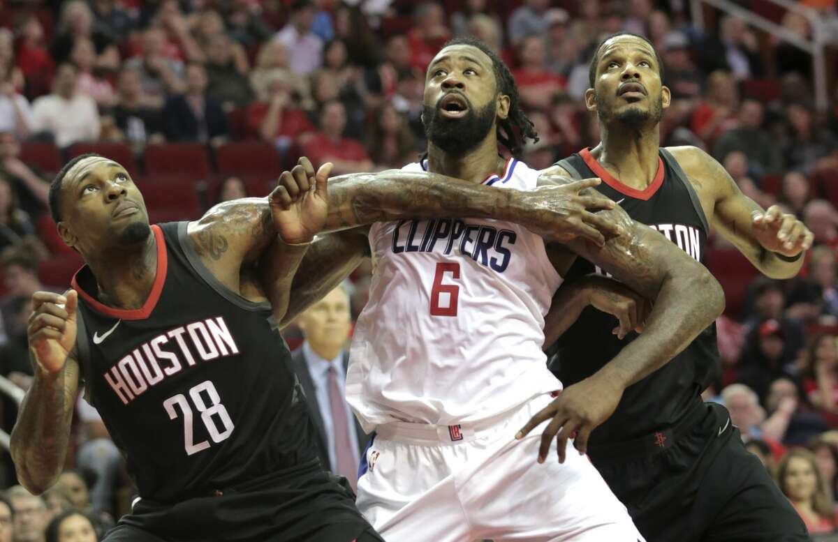 Houston Rockets forward Tarik Black (28) boxes out LA Clippers center DeAndre Jordan (6) with teammate Trevor Ariza (1) during the second half at the Toyota Center on Friday, Dec. 22, 2017, in Houston. Clippers won the game 128-118. ( Elizabeth Conley / Houston Chronicle )