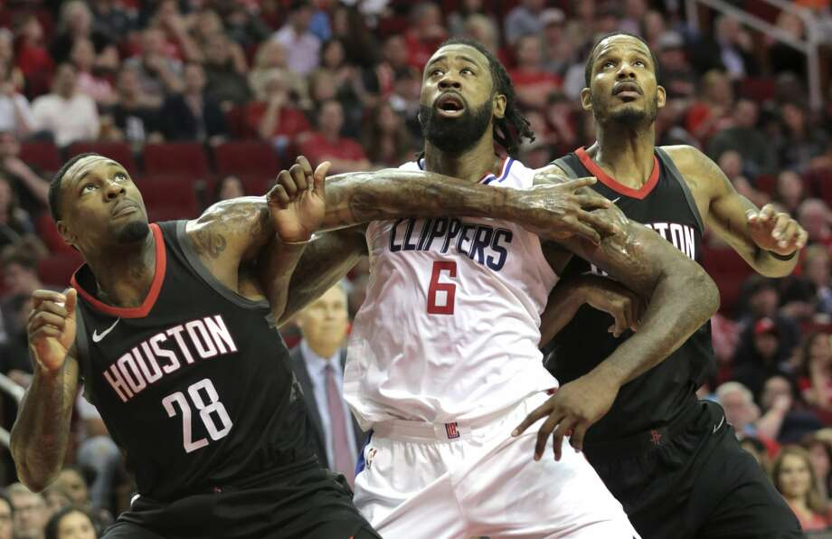 Houston Rockets forward Tarik Black (28) boxes out LA Clippers center DeAndre Jordan (6) with teammate Trevor Ariza (1) during the second half  at the Toyota Center on Friday, Dec. 22, 2017, in Houston. Clippers won the game 128-118. ( Elizabeth Conley / Houston Chronicle ) Photo: Elizabeth Conley/Houston Chronicle