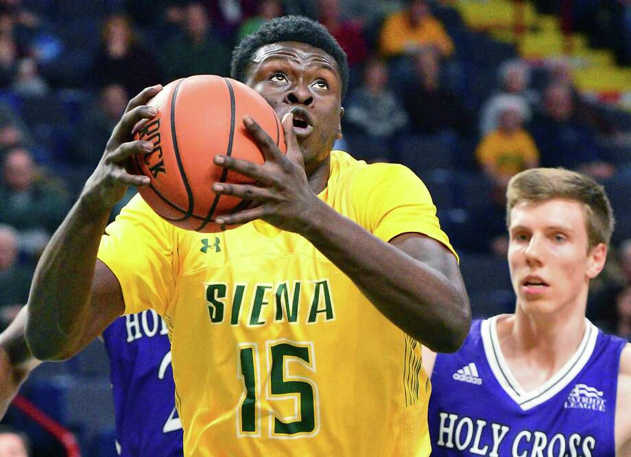 Siena's #15 Prince Oduro goes to the net during Friday night's game against Holy Cross at the Times Union Center Dec. 22, 2017 in Albany, NY.  (John Carl D'Annibale / Times Union) Photo: John Carl D'Annibale / 20041658A