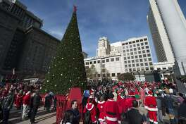 Thousands of people dressed as Santa Claus gather at Union Square in San Francisco to celebrate SantaCon in early December.