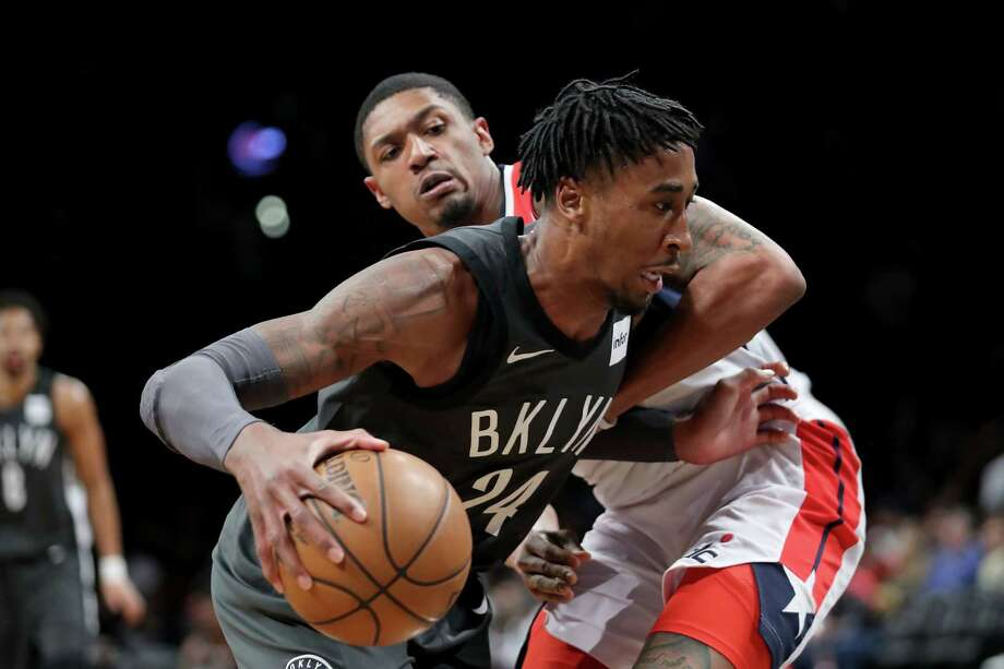 NEW YORK, NY - DECEMBER 22: Rondae Hollis-Jefferson #24 of the Brooklyn Nets works against Bradley Beal #3 of the Washington Wizards in the first quarter during their game at Barclays Center on December 22, 2017 in the Brooklyn borough of New York City. NOTE TO USER: User expressly acknowledges and agrees that, by downloading and or using this photograph, User is consenting to the terms and conditions of the Getty Images License Agreement.  (Photo by Abbie Parr/Getty Images) Photo: Abbie Parr / 2017 Getty Images
