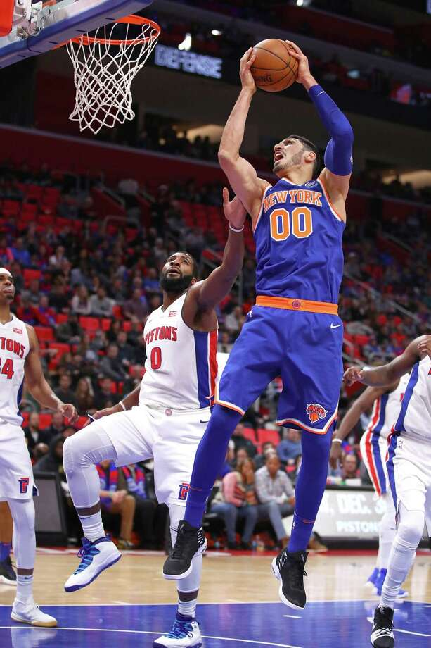 DETROIT, MI - DECEMBER 22: Enes Kanter #00 of the New York Knicks grabs a rebound next to Andre Drummond #0 of the Detroit Pistons during the second half at Little Caesars Arena on December 22, 2017 in Detroit, Michigan. NOTE TO USER: User expressly acknowledges and agrees that, by downloading and or using this photograph, User is consenting to the terms and conditions of the Getty Images License Agreement. (Photo by Gregory Shamus/Getty Images) Photo: Gregory Shamus / 2017 Getty Images