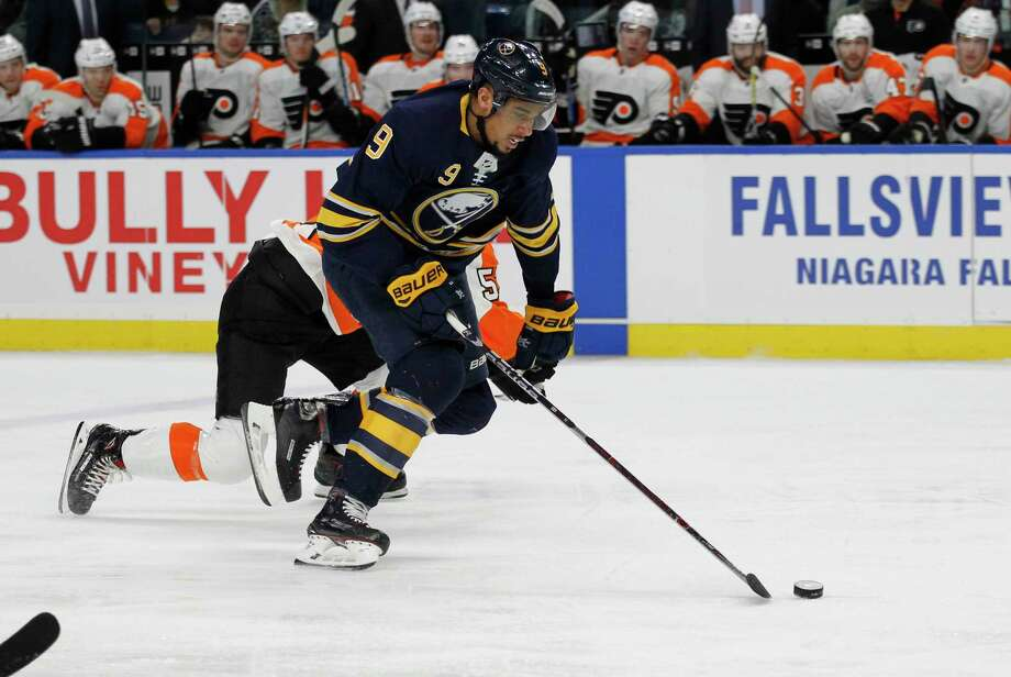 Buffalo Sabres forward Evander Kane (9) skates the puck into the zone during the first period of an NHL hockey game against the Philadelphia Flyers, Friday, Dec. 22, 2017, in Buffalo, N.Y. (AP Photo/Jeffrey T. Barnes) Photo: Jeffrey T. Barnes / 2017