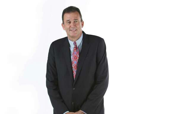 Gregg Versey, managing director and CEO of LNG Ltd., stands for a portrait in the Houston Chronicle photo studio.