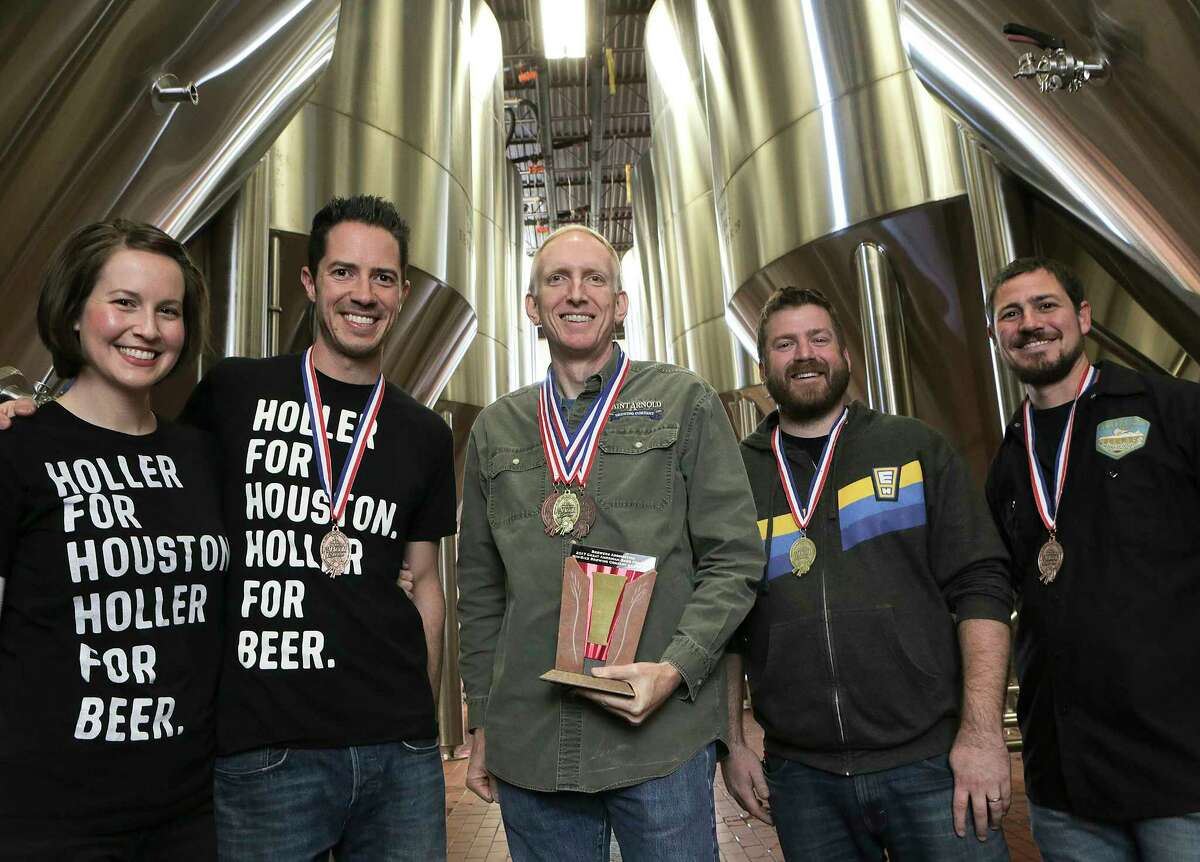Award-winning brewers gather at Saint Arnold Brewing Co. From left are Kathryn and John Holler of Holler Brewing, Brock Wagner of Saint Arnold, Casey Motes of Eureka Heights Brew Co. and Mark Dell'Osso of Galveston Island Brewing.