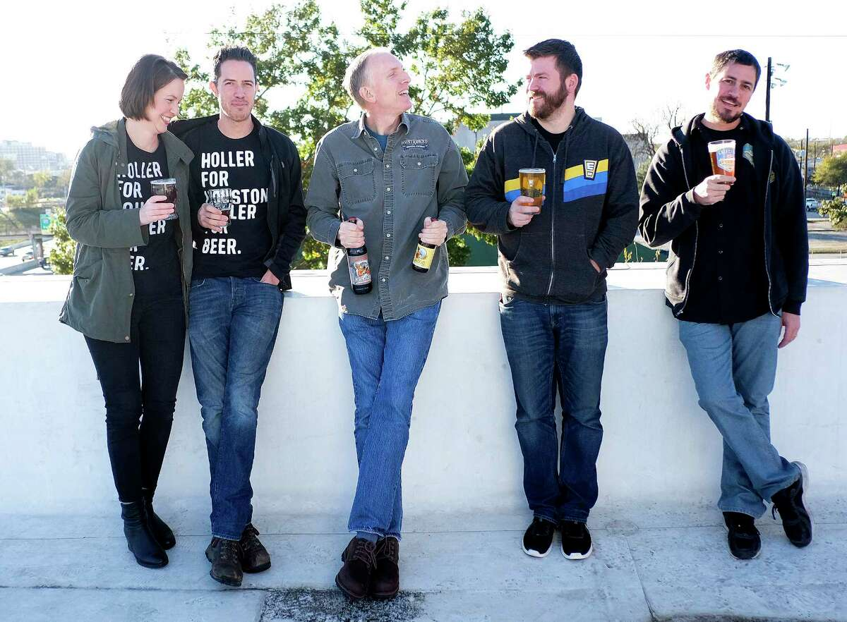 Award-winning Houston brewers pose for a photo at St. Arnold Brewing Company on Friday, Dec. 8, 2017, in Houston. They include Karhryn (from left) and John Holler of Holler Brewing, Brock Wagner, owner of Saint Arnold, Casey Motes of Eureka Heights Brew Co., and Mark Dell'Osso of Galveston Island Brewing. ( Elizabeth Conley / Houston Chronicle )