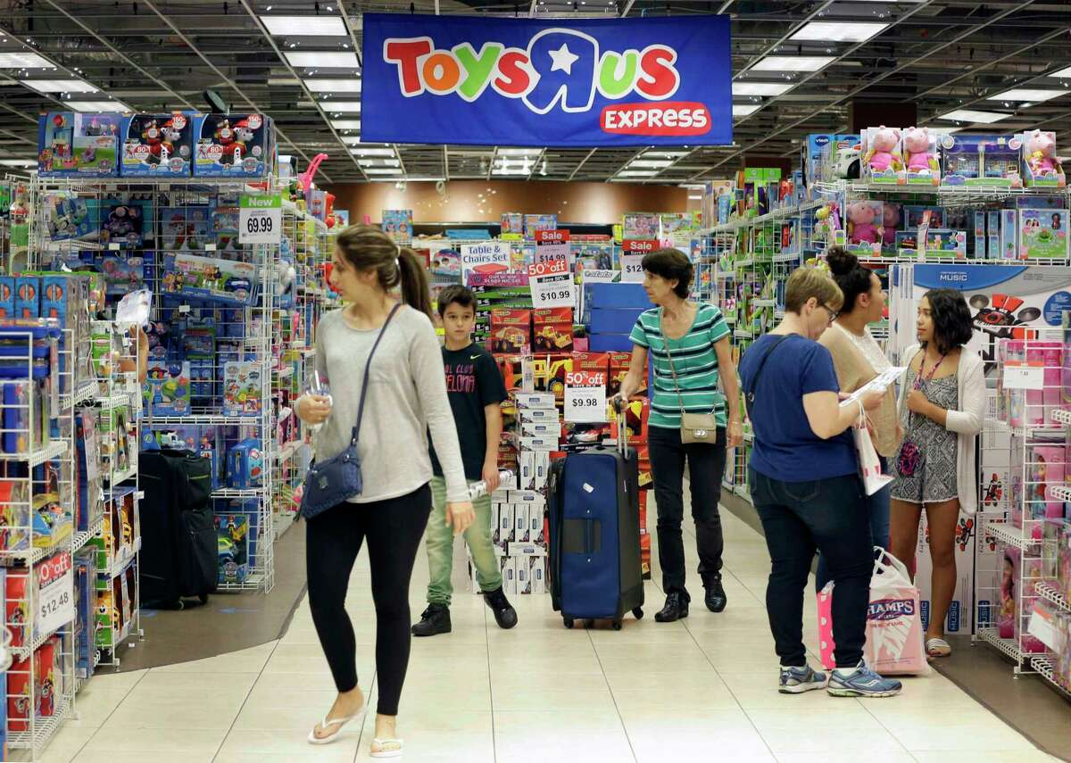Shoppers browse at a Toys R Us in Miami. The FBI says toys connected to the internet could be a target for crooks who may listen in on conversations or use them to steal a child's personal data.