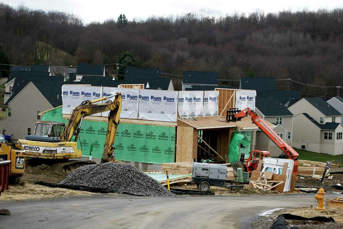 In this Wednesday, March 1, 2017, photo, new home construction is underway in a housing plan in Zelienople, Pa. On Tuesday, Dec. 19, 2017, the Commerce Department reports on the pace of U.S. home construction in November. (AP Photo/Keith Srakocic)