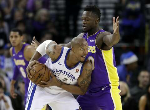 059093379f4925 Golden State Warriors forward David West (3) looks past Los Angeles Lakers  forward Julius