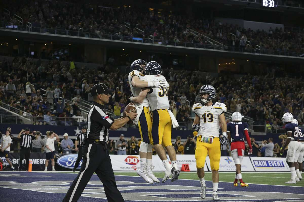 Dallas Highland Park players Carson Bryant (10) and Paxton Alexander (35) celebrate Alexander's touchdown during the second half of the Class 5A Division I State Championship Game at AT&T Stadium on Friday, Dec. 22, 2017, in Arlington. Manvel Mavericks lost to Dallas Highland Park Scots 53-49. ( Yi-Chin Lee / Houston Chronicle )