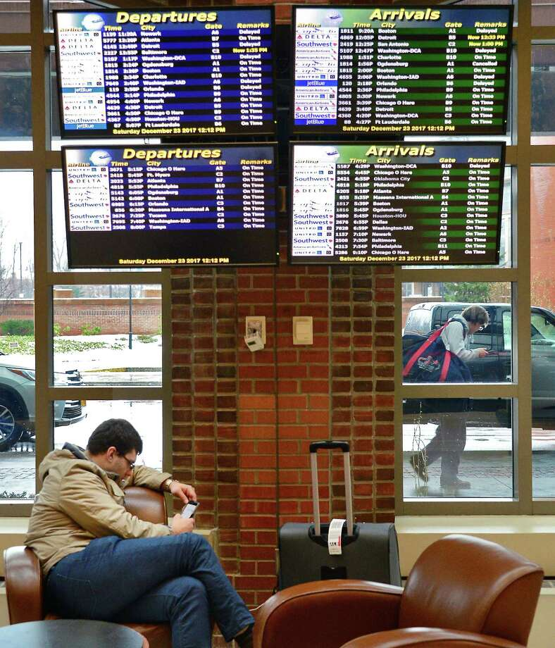 Holiday travel moves easily through Albany County International Airport despite a few delays and cancellations Saturday Dec. 23, 2017 in Colonie, NY.  (John Carl D'Annibale / Times Union) Photo: John Carl D'Annibale, Albany Times Union