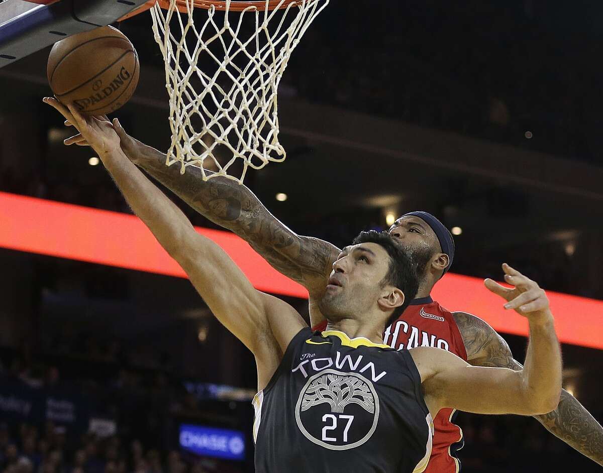 """Warriors center Zaza Pachulia (27) sports the tree-emblazoned """"The Town"""" jersey on Nov. 25 against the New Orleans Pelicans. Golden State willwear the Town and the tree for the second time on Saturday during a home game against the Denver Nuggets."""