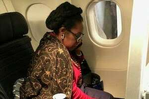A woman claims United Airlines gave her first-class seat to Rep. Shelia Jackson Lee.