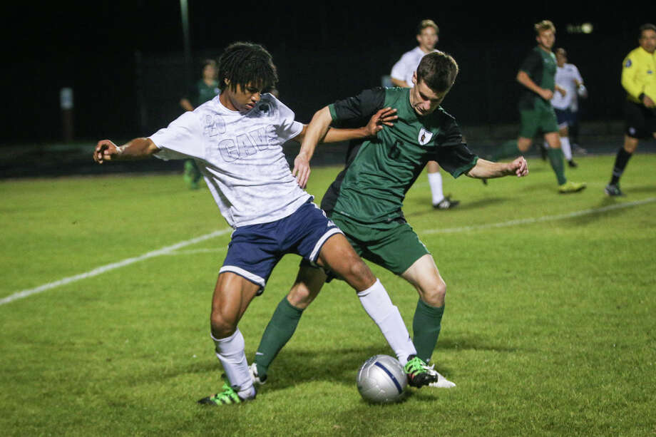 College Park's Garrett Gordon (20) and The Woodlands' Colin Spaulding (6) battle for possession during the varsity boys soccer game on Friday, Feb. 17, 2017, at College Park High School. (Michael Minasi / Chronicle) Photo: Michael Minasi, Staff Photographer / © 2017 Houston Chronicle