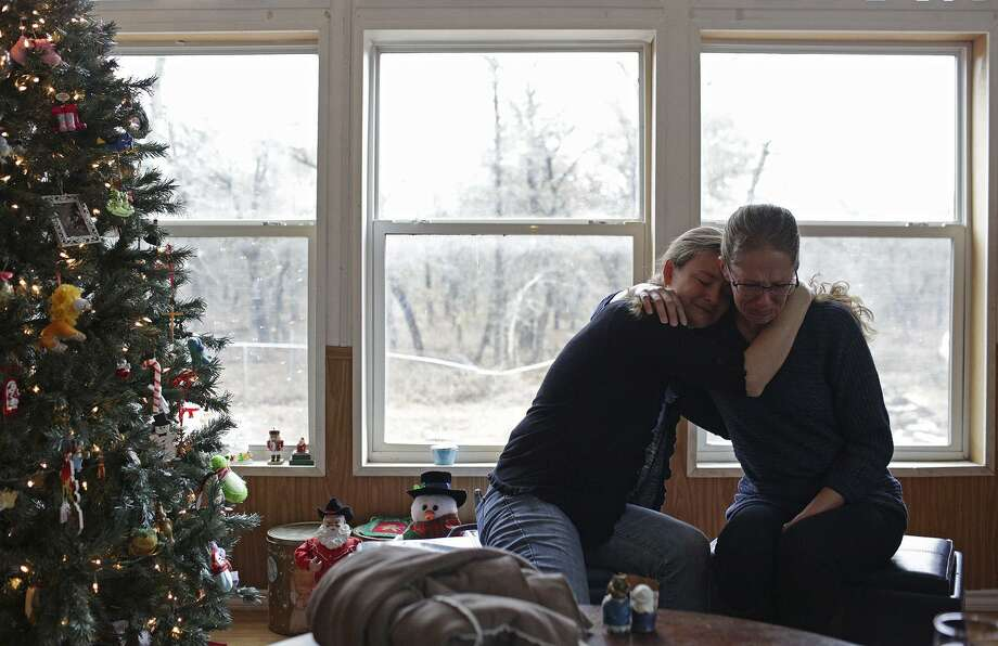 Sarah Slavin embraces Jennifer Holcombe at Jennifer's home on Dec. 7, 2017 as Jennifer became emotional while talking about losing her daughter in the shooting at First Baptist Church in Sutherland Springs last month. Sarah is also a Holcombe and lost her parents, her brother (Jennifer's husband), a sister-in-law, three nieces, a nephew, an unborn niece or nephew and a close friend they considered family, in the shooting at First Baptist Church in Sutherland Springs. Photo: SAN ANTONIO EXPRESS-NEWS / SAN ANTONIO EXPRESS-NEWS / SAN ANTONIO EXPRESS-NEWS