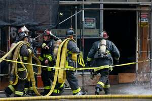 Firefighters enter a building undergoing renovation at Mason and Eddy streets after a fire started on the third floor in San Francisco, Calif. on Saturday, Dec. 23, 2017.
