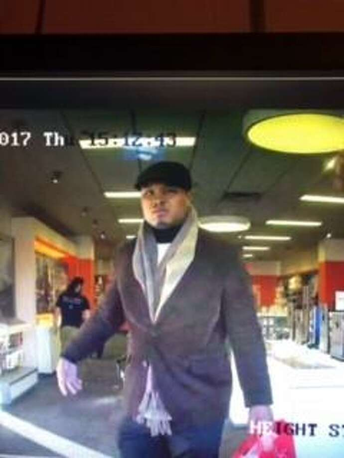 New Haven police need help in identifying this suspect in a theft from the AT& store on Whalley Avenue Photo: Surveillance Photo, Courtesy Of New Haven Police Dept.