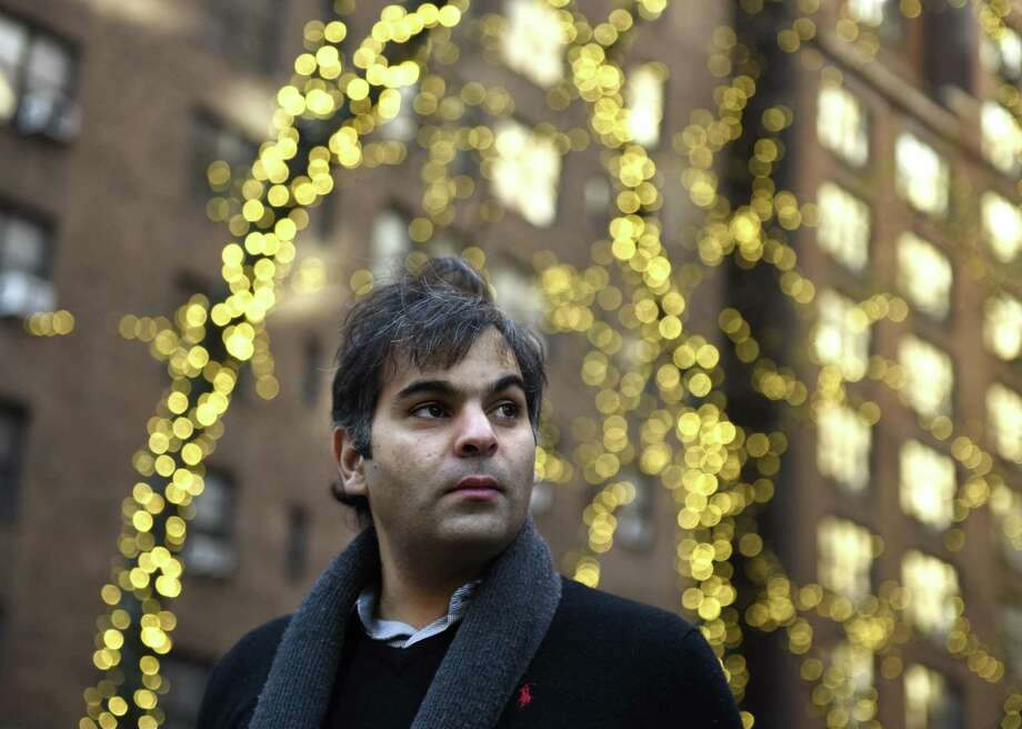 Polyphony Co-founder and Polyphony Education Executive Director Nabeel Abboud-Ashkar poses by an array of holiday lights in New York, N.Y. Tuesday, Nov. 28, 2017. An acclaimed violinist, Abboud-Ashkar leads the first-ever classical music conservatory in the Arab-Israeli city of Nazareth, Israel. Polyphony brings together people of different races, religions and cultural heritages to share common ground in music study and performance at the conservatory. Photo: Tyler Sizemore / Hearst Connecticut Media / Greenwich Time
