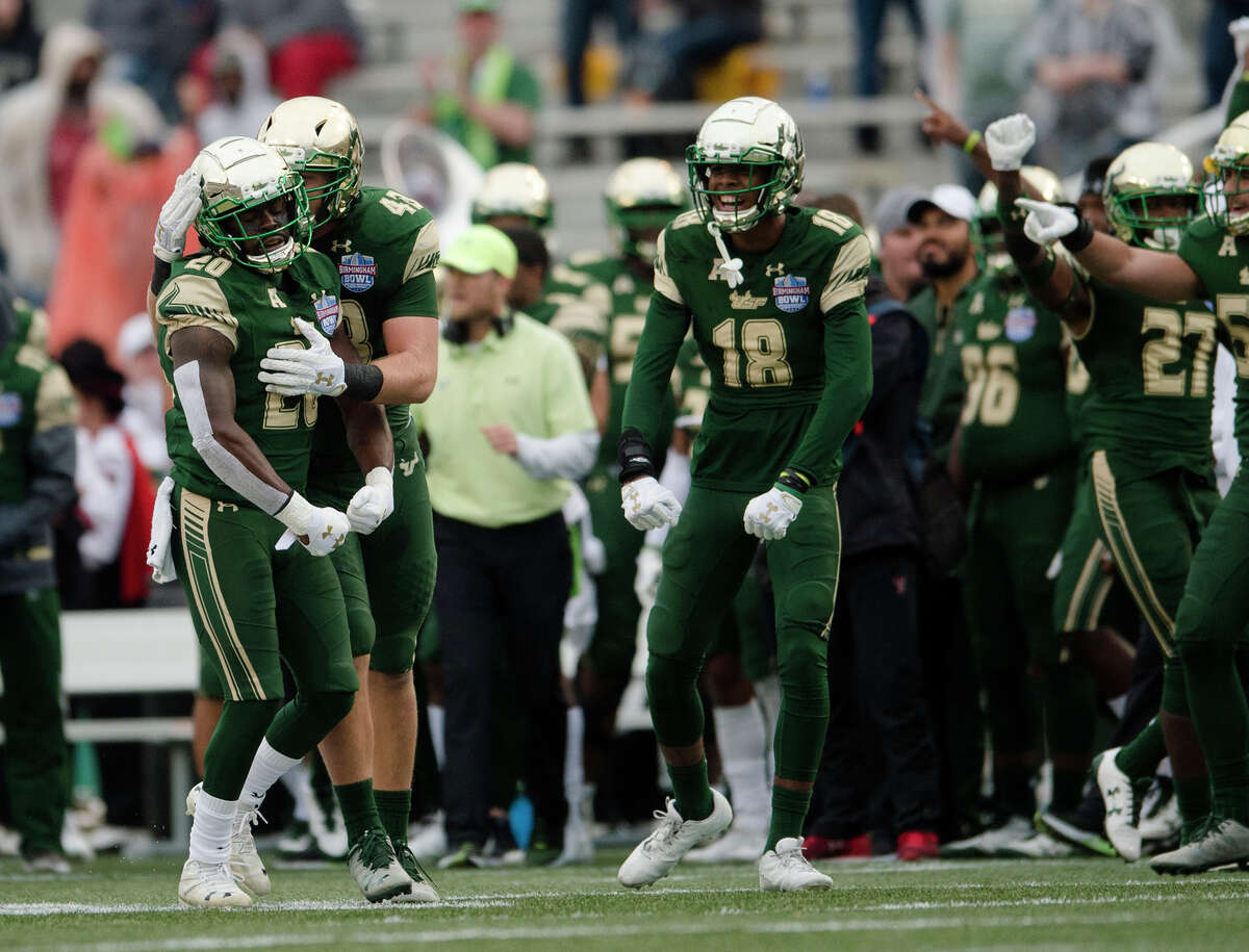 South Florida safety Devin Abraham (20) is greeted by South Florida linebacker Auggie Sanchez (43) after intercepting a pass against Texas Tech during the first half the Birmingham Bowl NCAA college football game, Saturday, Dec. 23, 2017 in Birmingham, Ala.