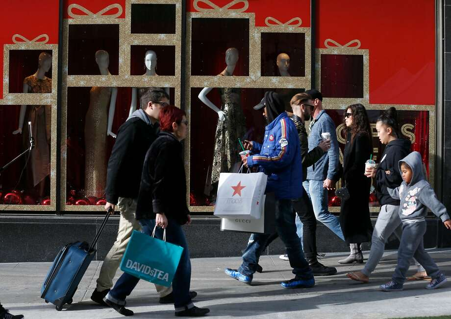 Christmas shoppers stride down the sidewalks of Stockton Street near Union Square in San Francisco to visit brick-and-mortar stores for last-minute gifts. Photo: Paul Chinn, The Chronicle