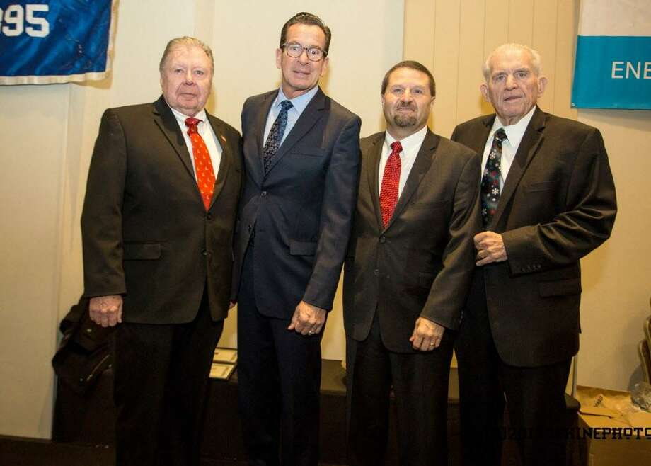 Gov. Dannel P. Malloy was the keynote speaker at last week's Middlesex County Chamber of Commerce member breakfast meeting at the Radisson Hotel Cromwell. From left are Chamber Vice Chairman Jay Polke, Malloy, Chamber Chairman Rick Morin and Chamber President Larry McHugh. Photo: Contributed Photo / (c)DE KINE PHOTO LLC