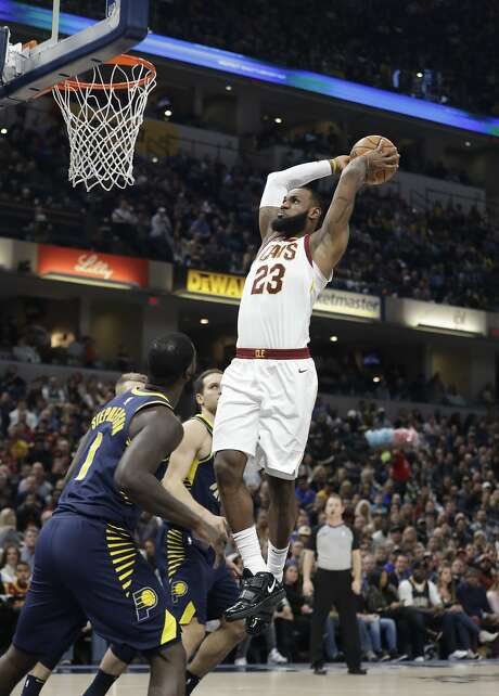 Cleveland Cavaliers' LeBron James (23) dunks during the first half of an NBA basketball game against the Indiana Pacers, Friday, Dec. 8, 2017, in Indianapolis. (AP Photo/Darron Cummings) Photo: Darron Cummings, Associated Press