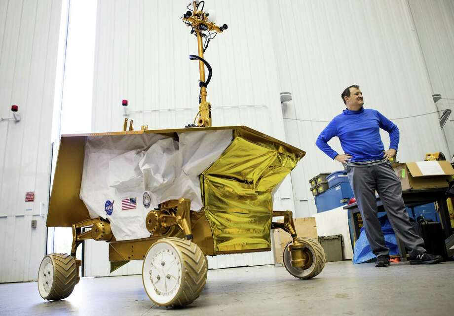 Bill Bluethmann talks about the Resource Prospector at the Johnson Space Center in Houston. The rover is designed to drill into the moon's crust in search of water. Bluethmann is the rover's element lead at the center. Photo: Brett Coomer /Houston Chronicle / © 2017 Houston Chronicle