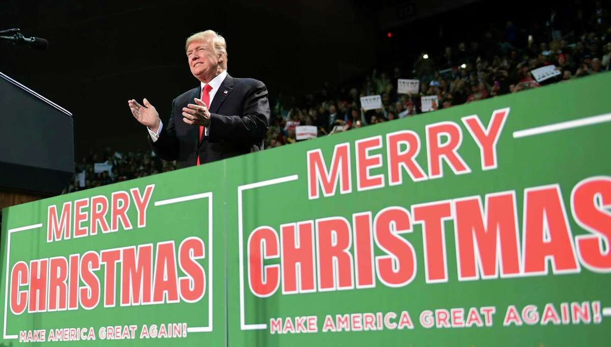 President Donald Trump takes to the stage at a campaign-style rally at the Pensacola Bay Center in Florida. For weeks, he's been sprinkling his public remarks with Christmas tidings.