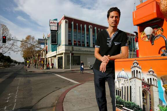 Liam Chinn, executive director of Restore Oakland with their newly acquired building behind him,  on 34th Ave. and international Blvd. in Oakland, Ca., on Tuesday December 19, 2017.  Restore Oakland is opening a community advocacy and training center in the heart of the Fruitvale neighborhood.