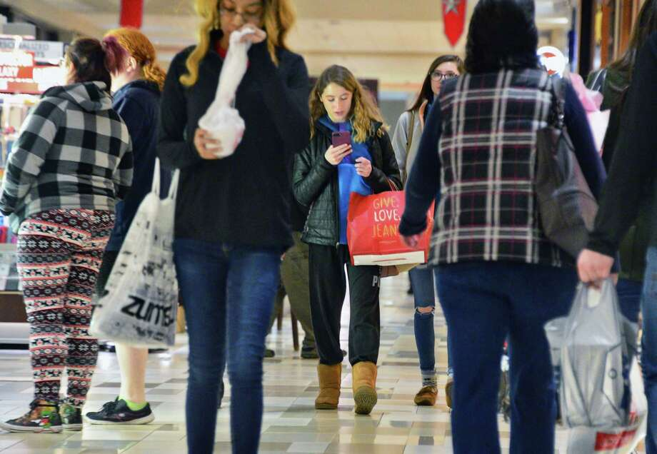 Holiday shoppers look for last minute gifts at Crossgates Mall Saturday Dec. 23, 2017 in Guilderland, NY.  (John Carl D'Annibale / Times Union) Photo: John Carl D'Annibale / 20042486A