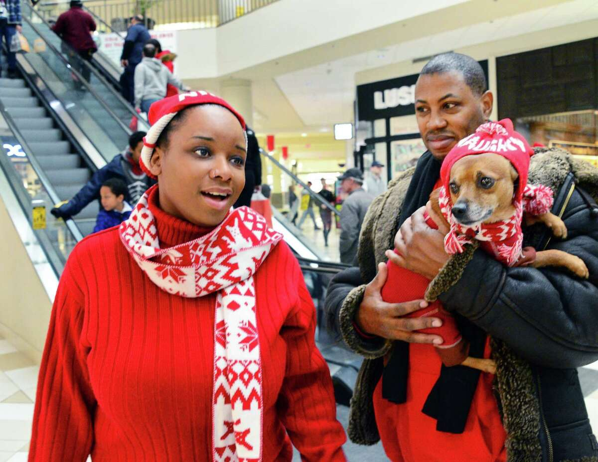 Their holiday shopping complete, Raven Webb and Jeffrey Sanders bring their dog Brooklyn to Crossgates Mall for a photo with Santa Saturday Dec. 23, 2017 in Guilderland, NY. (John Carl D'Annibale / Times Union)
