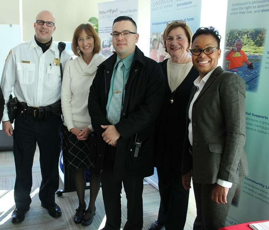 Shown, l to r, New Haven police Lt. Jason Minardi; Kathleen Titsworth, Banking Outreach coordinator, state Department of Banking; New Haven police Detective Fred Salmeron; Angela DeLeon, Masters Program coordinator, Peoples United Bank, and New Haven Detective Rosealee Reid. Photo: Contributed Photo