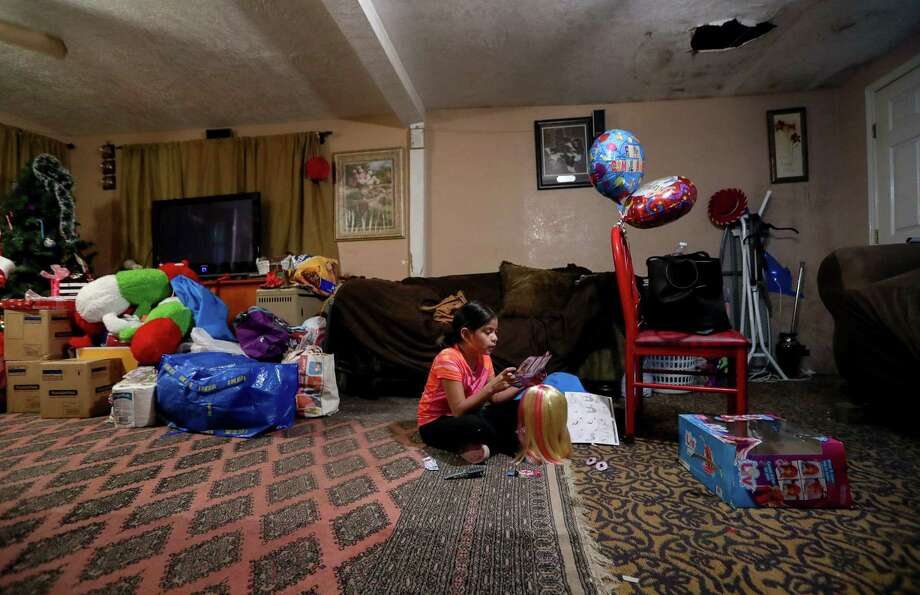Betzabe Gomez wrote a letter to Santa asking him to fix her hurricane-damaged home.  Photo: Jon Shapley, Staff Photographer / © 2017 Houston Chronicle