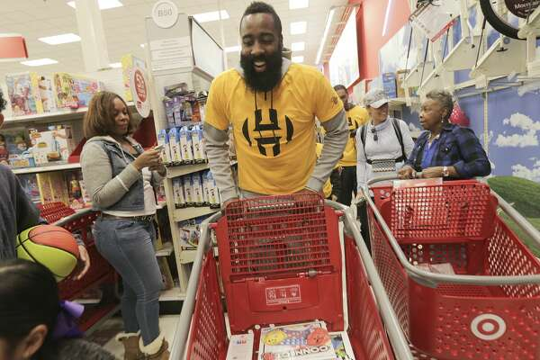 0fd2b070aff8 1of14Houston Rockets guard James Harden laughs after a woman recognized him  at Target during a shopping spree with families in need on Saturday